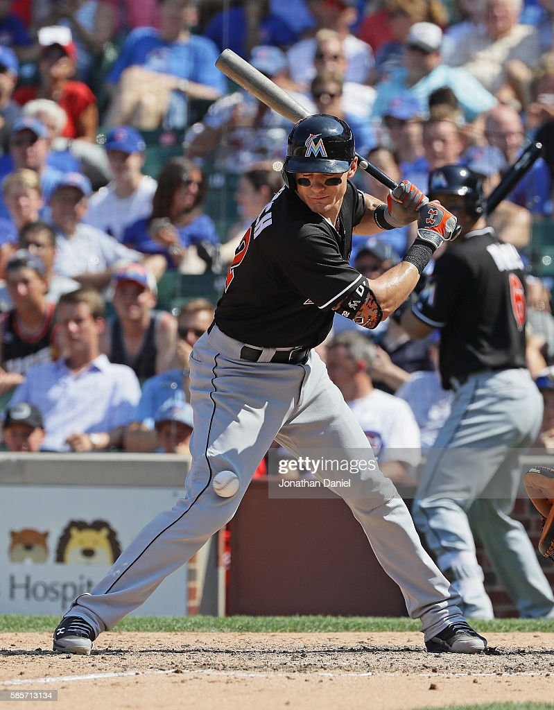 Derek Dietrich #32 of the Miami Marlins is hit on the knee by a pitch in the 7th inning against the Chicago Cubs at Wrigley Field on August 3, 2016 in Chicago, Illinois.