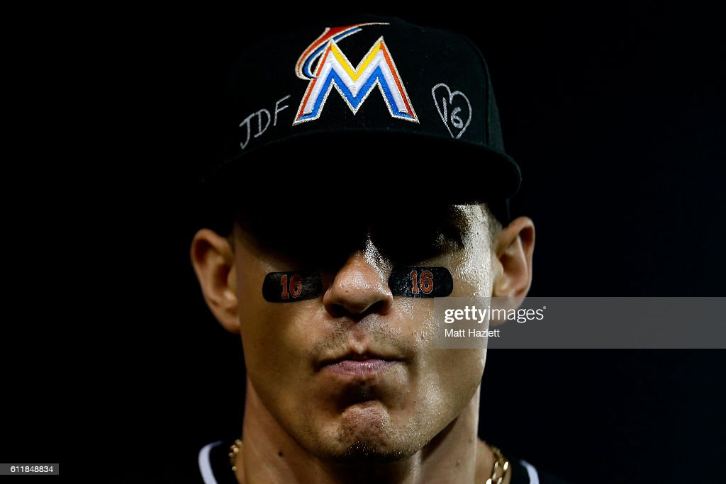 Derek Dietrich #32 of the Miami Marlins looks on while showing support for Miami Marlins pitcher Jose Fernandez, who died in a boating accident, in the eighth inning against the Washington Nationals at Nationals Park on October 1, 2016 in Washington, DC.