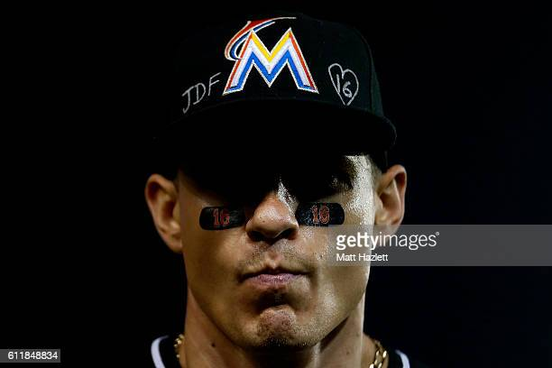 Derek Dietrich of the Miami Marlins looks on while showing support for Miami Marlins pitcher Jose Fernandez, who died in a boating accident, in the...