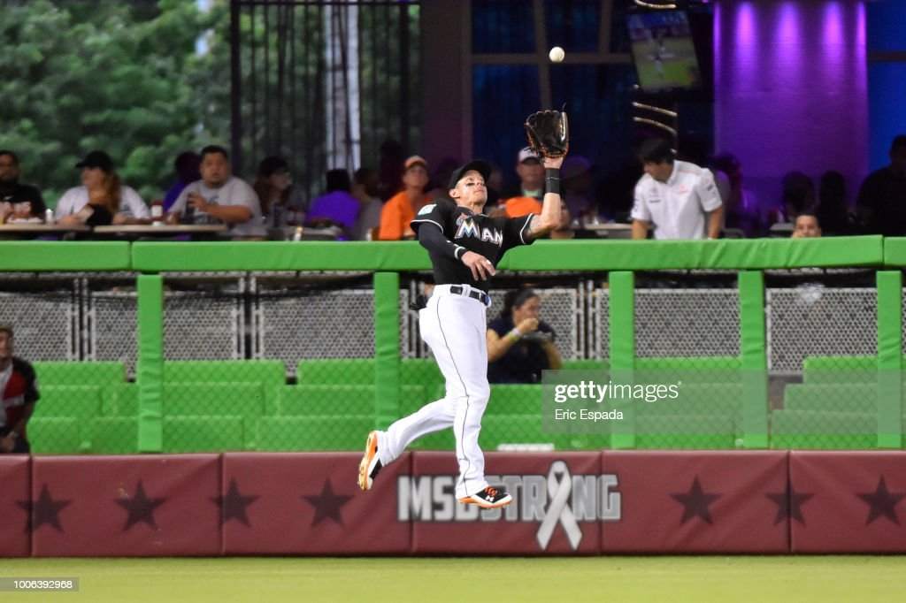 Derek Dietrich #32 of the Miami Marlins makes a catch in the outfield during the second inning against the Miami Marlins at Marlins Park on July 27, 2018 in Miami, Florida.