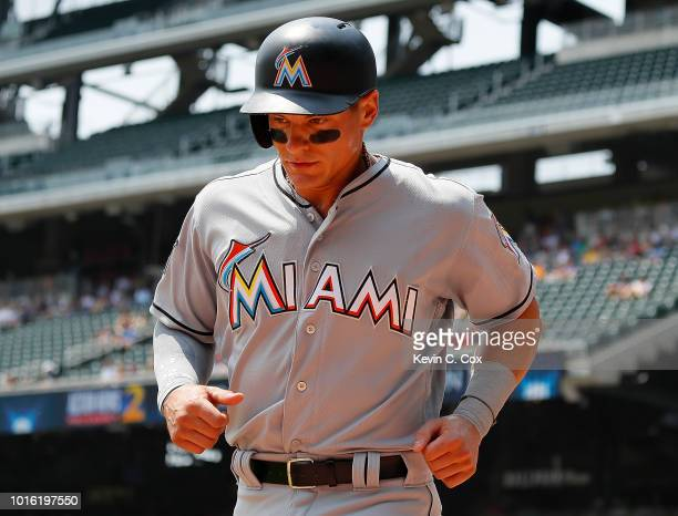 Derek Dietrich of the Miami Marlins reacts after scoring on a RBI double hit by Isaac Galloway in the first inning against the Atlanta Braves during...
