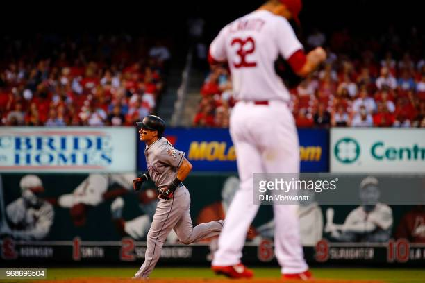 Derek Dietrich of the Miami Marlins rounds the bases after hitting a tworun home runagainst the St Louis Cardinals in the third inning at Busch...