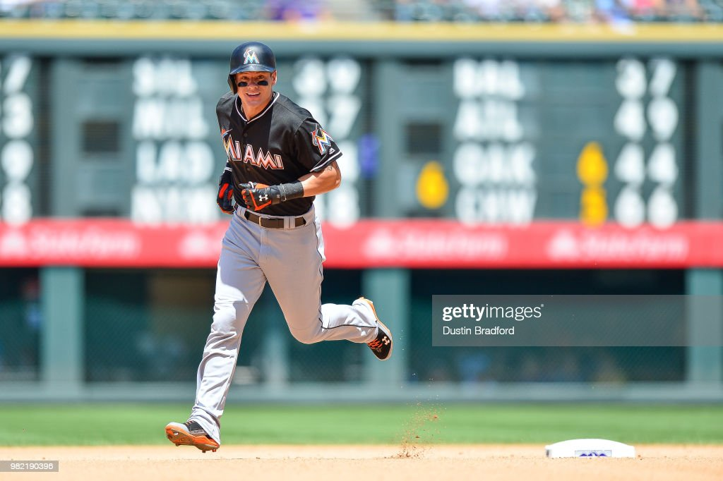 Derek Dietrich #32 of the Miami Marlins rounds the bases after hitting a fourth inning solo homerun against the Colorado Rockies at Coors Field on June 23, 2018 in Denver, Colorado.