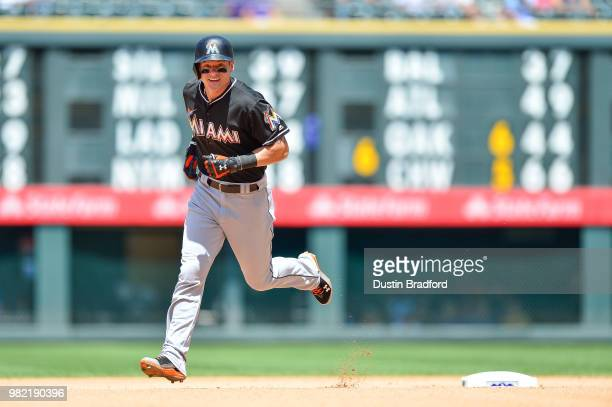 Derek Dietrich of the Miami Marlins rounds the bases after hitting a fourth inning solo homerun against the Colorado Rockies at Coors Field on June...