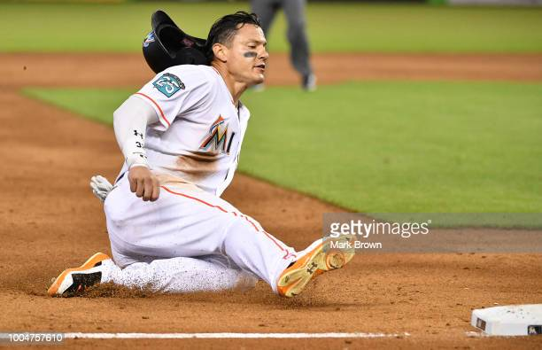 Derek Dietrich of the Miami Marlins slides into third base in the sixth inning against the Atlanta Braves at Marlins Park on July 24, 2018 in Miami,...