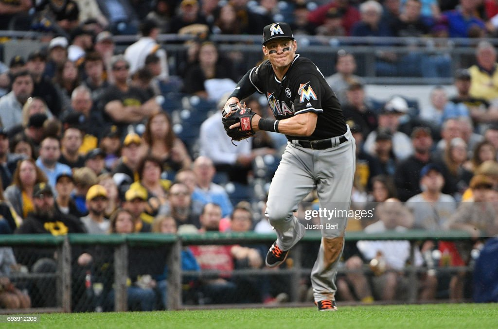 Derek Dietrich #32 of the Miami Marlins throws to first base for a force out of Elias Diaz #32 of the Pittsburgh Pirates in the fourth inning during the game at PNC Park on June 8, 2017 in Pittsburgh, Pennsylvania.