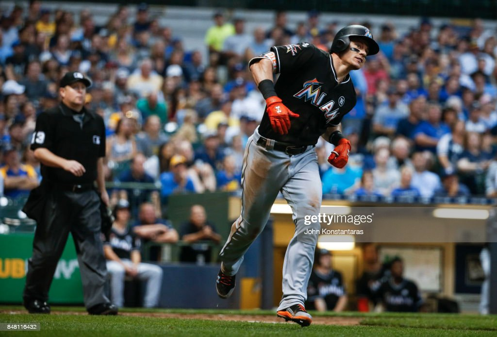 Derek Dietrich #32 of the Miami Marlins watches his home run leave the park during the third inning against the Milwaukee Brewers at Miller Park on September 16, 2017 in Milwaukee, Wisconsin.