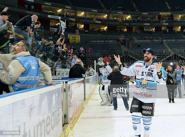 Derek Dinger celebrates the championship after game seven of the DEL playoff final on April 29, 2014 in Cologne, Germany.