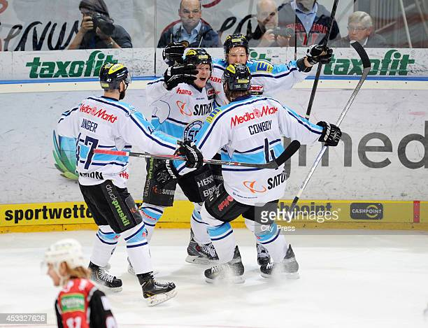 Derek Dinger Christoph Gawlik Patrick Hager and Timothy Conboy celebrate the 01 during game seven of the DEL playoff final on April 29 2014 in...