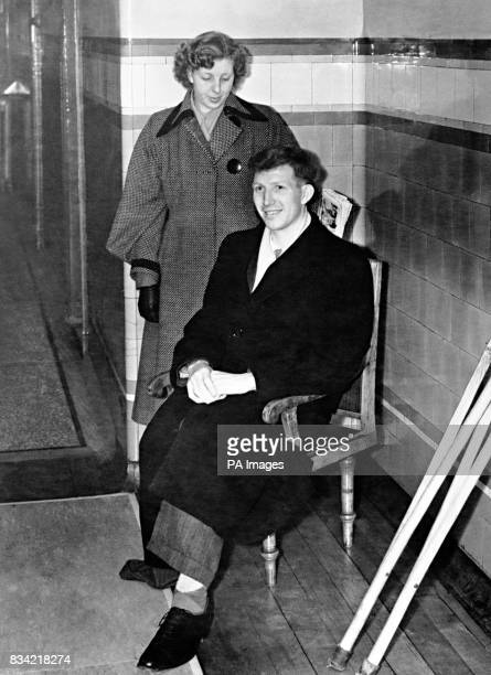 Derek Dooley the Sheffield Wednesday forward waiting for the ambulance to take him home from the Preston Royal Infirmary after having his leg...