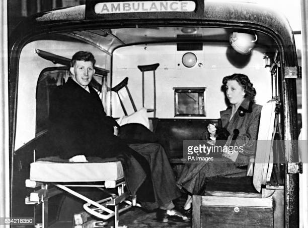 Derek Dooley the Sheffield Wednesday forward with his wife in an ambulance to take him home from the Preston Royal Infirmary after having his leg...