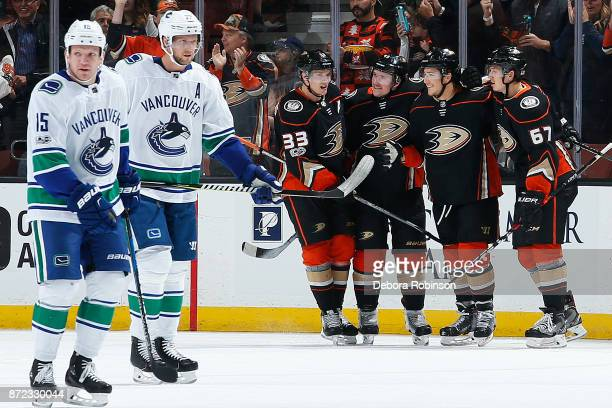 Derek Dorsett and Daniel Sedin of the Vancouver Canucks react as Jakob Silfverberg Sami Vatanen Brandon Montour and Rickard Rakell of the Anaheim...