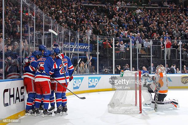 Derek Dorsett Dominic Moore and Ryan McDonagh of the New York Rangers celebrate with teammates after a firstperiod goal against the Philadelphia...