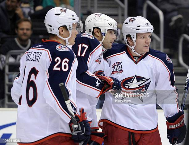 Derek Dorsett of the Columbus Blue Jackets celebrates his goal with Andrew Murray and Samuel Pahlsson for a 10 lead over the Los Angeles Kings during...
