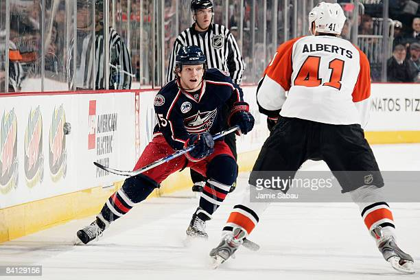 Derek Dorsett of the Columbus Blue Jackets flips the puck past Andrew Alberts of the Philadelphia Flyers on December 27 2008 at Nationwide Arena in...