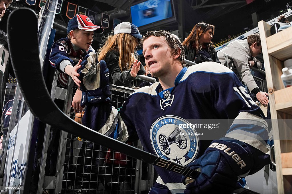 Derek Dorsett #15 of the Columbus Blue Jackets greets fans as he takes the ice for pre-game warm ups before playing against the Detroit Red Wings on February 2, 2013 at Nationwide Arena in Columbus, Ohio.