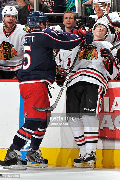 Derek Dorsett of the Columbus Blue Jackets is called for roughing after hitting Andrew Shaw of the Chicago Blackhawks during the second period on...
