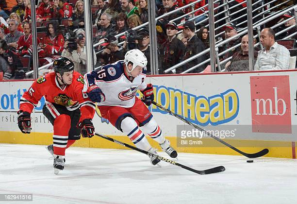Derek Dorsett of the Columbus Blue Jackets is defended by Andrew Shaw of the Chicago Blackhawks during the NHL game on March 01 2013 at the United...