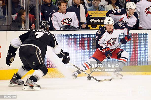 Derek Dorsett of the Columbus Blue Jackets skates with the puck against Rob Scuderi of the Los Angeles Kings at Staples Center on February 1 2012 in...