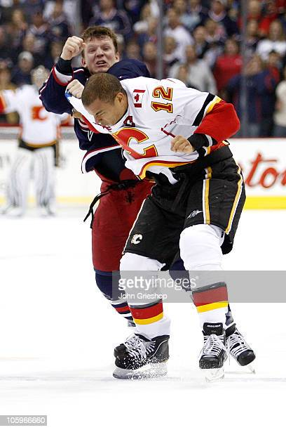 Derek Dorsett of the Columbus Blue Jackets throws a punch while fighting with Jarome Iginla of the Calgary Flames during the first period on October...