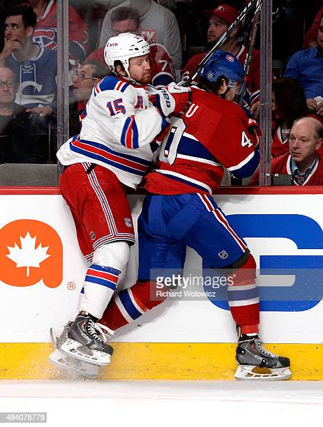 Derek Dorsett of the New York Rangers and Nathan Beaulieu of the Montreal Canadiens collide against the boards during Game Five of the Eastern...