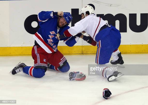 Derek Dorsett of the New York Rangers fights with Brandon Prust of the Montreal Canadiens during the first period in Game Three of the Eastern...
