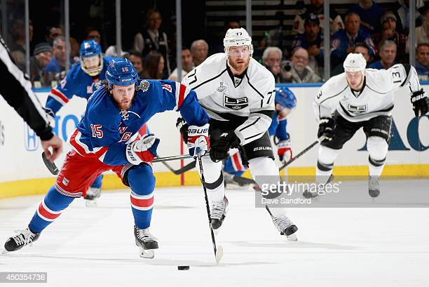 Derek Dorsett of the New York Rangers is chased by Jeff Carter of the Los Angeles Kings during the first period of Game Three of the 2014 Stanley Cup...