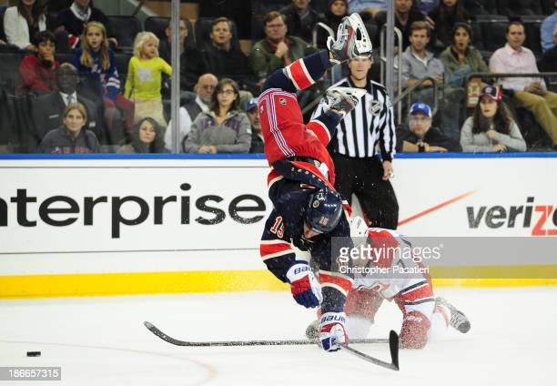 Derek Dorsett of the New York Rangers is checked by Ryan Murphy of the Carolina Hurricanes during the second period at Madison Square Garden on...