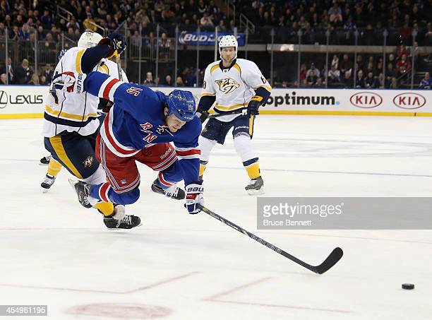 Derek Dorsett of the New York Rangers is checked by Victor Bartley of the Nashville Predators during the second period at Madison Square Garden on...