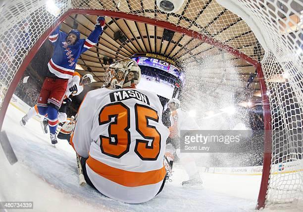 Derek Dorsett of the New York Rangers reacts after scoring a firstperiod goal against Steve Mason of the Philadelphia Flyers at Madison Square Garden...