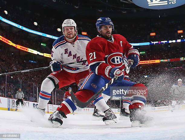 Derek Dorsett of the New York Rangers skates against Brian Gionta of the Montreal Canadiens in Game One of the Eastern Conference Final during the...