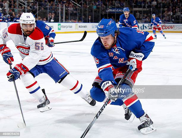 Derek Dorsett of the New York Rangers skates against Francis Bouillon of the Montreal Canadiens in the first period of Game Four of the Eastern...