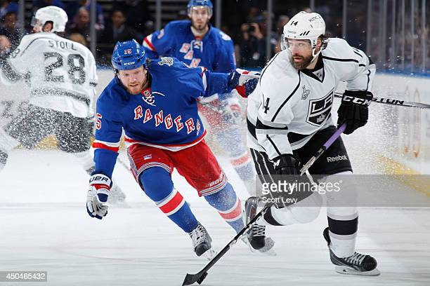 Derek Dorsett of the New York Rangers skates against Justin Williams of the Los Angeles Kings during Game Four of the 2014 NHL Stanley Cup Final at...
