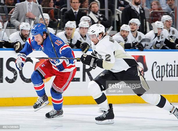 Derek Dorsett of the New York Rangers skates against Matt Niskanen of the Pittsburgh Penguins in Game Six of the Second Round of the 2014 Stanley Cup...