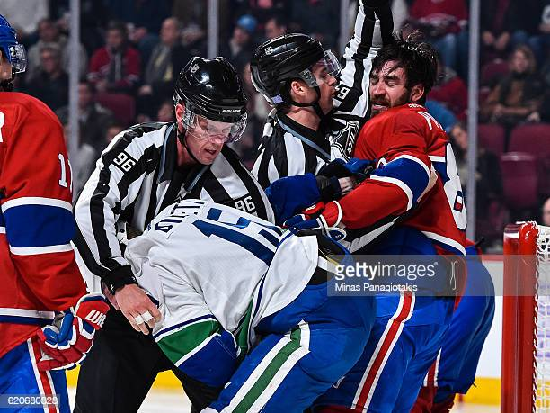 Derek Dorsett of the Vancouver Canucks and Greg Pateryn of the Montreal Canadiens get into a pushing match during the NHL game at the Bell Centre on...