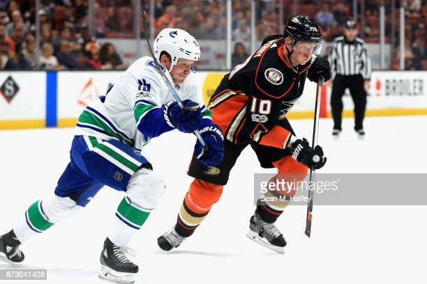 Derek Dorsett of the Vancouver Canucks battles Corey Perry of the Anaheim Ducks for a loose puck during the first period of a game at Honda Center on...
