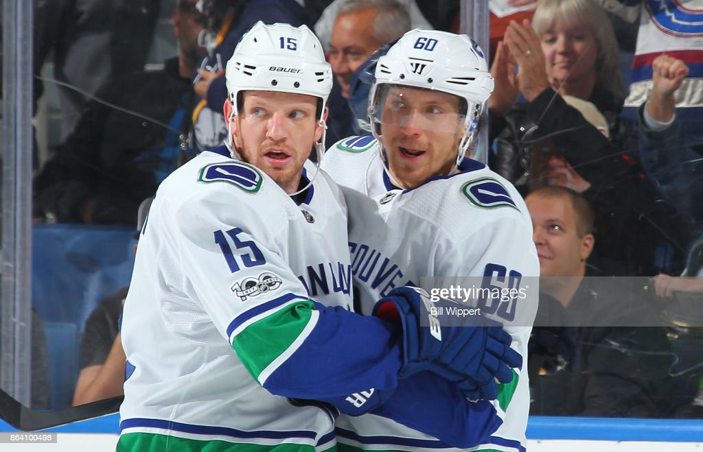 Derek Dorsett #15 of the Vancouver Canucks celebrates his empty net goal with Markus Granlund #60 during an NHL game against the Buffalo Sabres on October 20, 2017 at KeyBank Center in Buffalo, New York. Vancouver won, 4-2.
