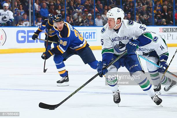 Derek Dorsett of the Vancouver Canucks handles the puck against the St Louis Blues at the Scottrade Center on March 25 2016 in St Louis Missouri