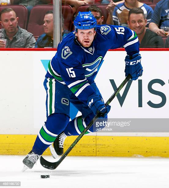 Derek Dorsett of the Vancouver Canucks skates up ice with the puck during their NHL game against the St Louis Blues at Rogers Arena October 16 2015...