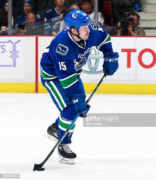 Derek Dorsett of the Vancouver Canucks skates up ice with the puck during their NHL game against the New York Rangers at Rogers Arena November 15...
