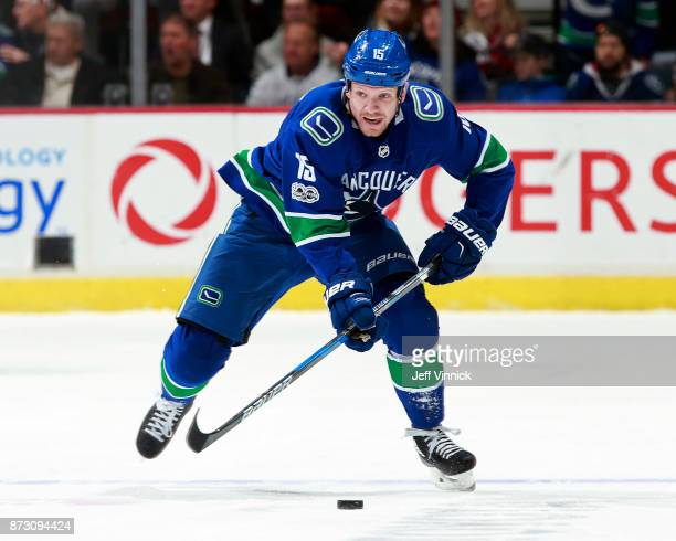 Derek Dorsett of the Vancouver Canucks skates up ice with the puck during their NHL game against the Pittsburgh Penguins at Rogers Arena November 4...