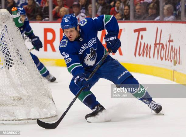 Derek Dorsett of the Vancouver Canucks skates with the puck during NHL action against the Washington Capitals on October 2017 at Rogers Arena in...