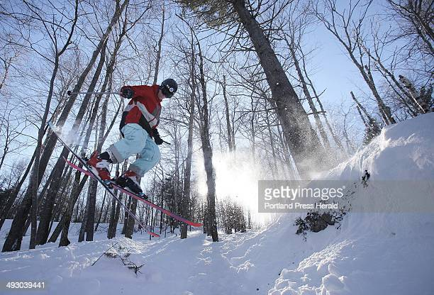 Derek Drechsler skis off a snowcovered rock in a glades at the Camden Snow Bowl on Thursday February 3 2011 New glades that were cut this past fall...