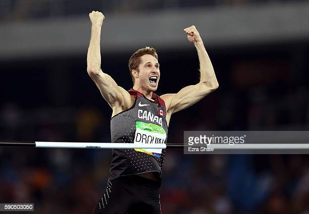 Derek Drouin of Canada reacts during the Men's High Jump Final on Day 11 of the Rio 2016 Olympic Games at the Olympic Stadium on August 16, 2016 in...