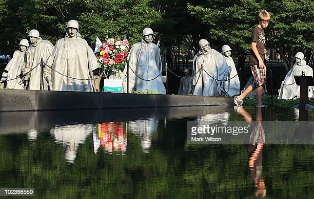 Derek Earnhart of Elk Township NJ visits the Korean War Memorial on June 24 2010 in Washington DC Sixty years ago today North Korean troops marched...