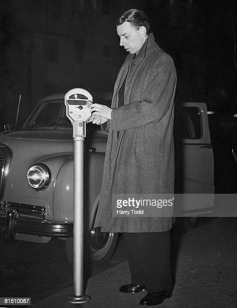 Derek Eastell using a demonstration parking meter in Brighton Terrace London 9th March 1953 The meter is outside the premises of Parking Meters Ltd...