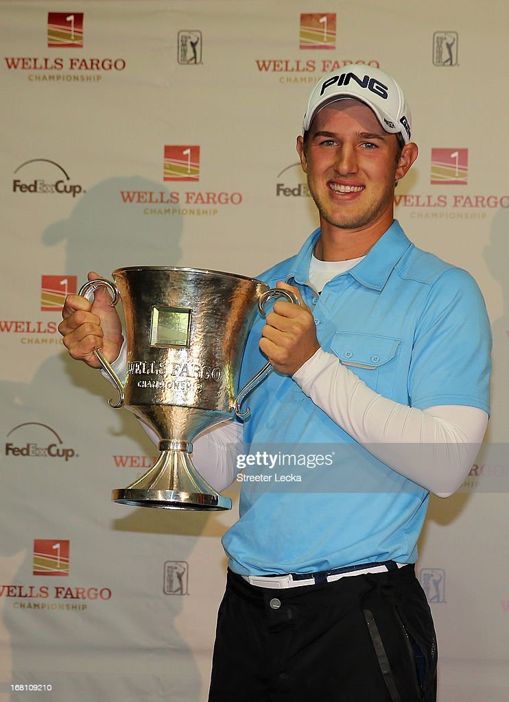 Derek Ernst poses with the trophy after defeating David Lynn of England in a playoff on the 18th hole during the final round of the Wells Fargo Championship at Quail Hollow Club on May 5, 2013 in Charlotte, North Carolina.