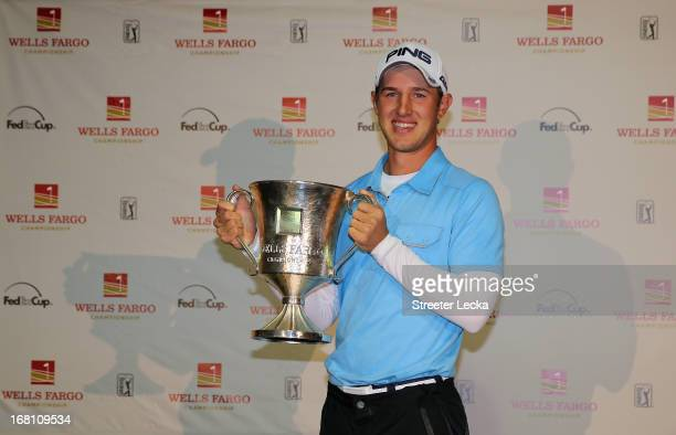 Derek Ernst poses with the trophy after defeating David Lynn of England in a playoff on the 18th hole during the final round of the Wells Fargo...