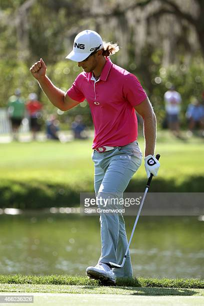 Derek Ernst reacts after chipping in for par on the 13th hole during the third round of the Valspar Championship at Innisbrook Resort Copperhead...