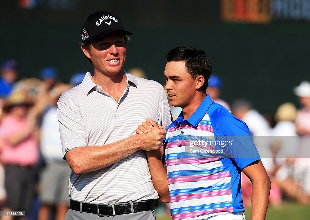 Derek Fathauer congratulates Rickie Fowler (R) after Fowler finished at 12 under par during the final round of THE PLAYERS Championship at the TPC Sawgrass Stadium course on May 10, 2015 in Ponte Vedra Beach, Florida.